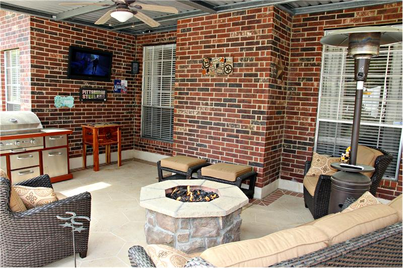 Covered back porch furnishes up well for a cozy entertainment area!