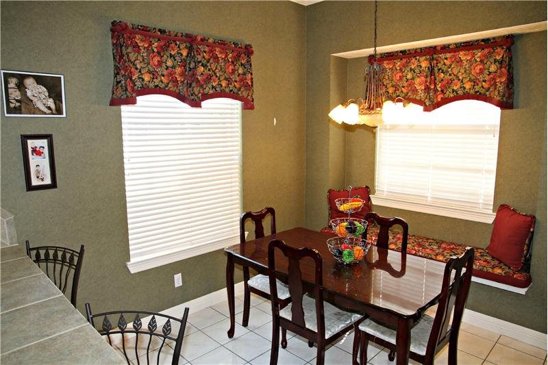 Breakfast nook has exit to the back patio and easy access to the Double Car + Golf Cart garage! Oh yeah!
