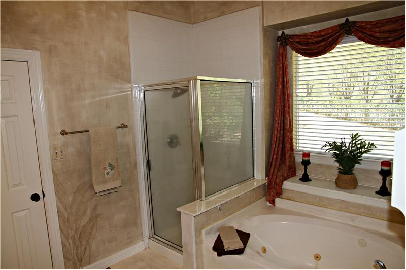 You will love the main bath with its jetted tub, glass shower, double sinks and HUGE walk in closet.