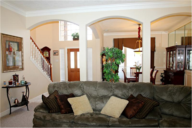 I love the arches in the formal living room and formal dining room.