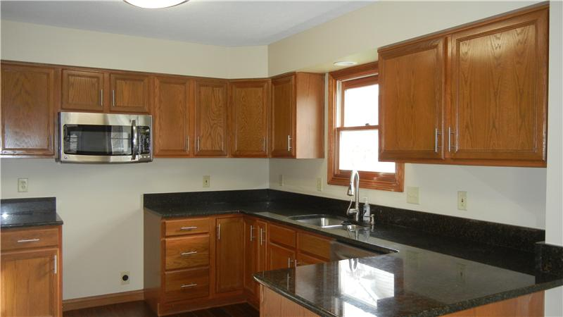 Gorgeous kitchen with new flooring, all new SS appliances and granite tops