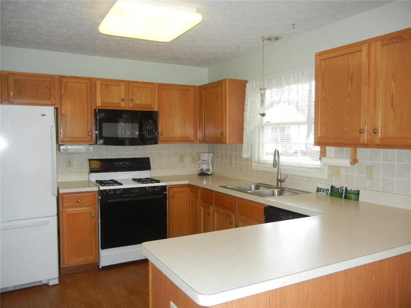 and beautiful ceramic tile back splash. All appliances included and the fridge is newer!