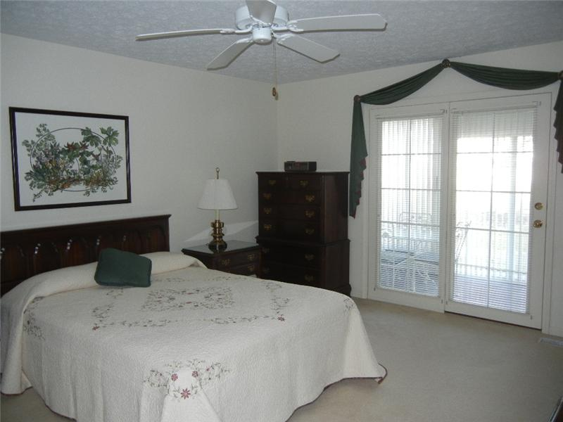 Convenient, spacious, and neutrally decorated master bedroom with private bath and access to the enclosed porch!