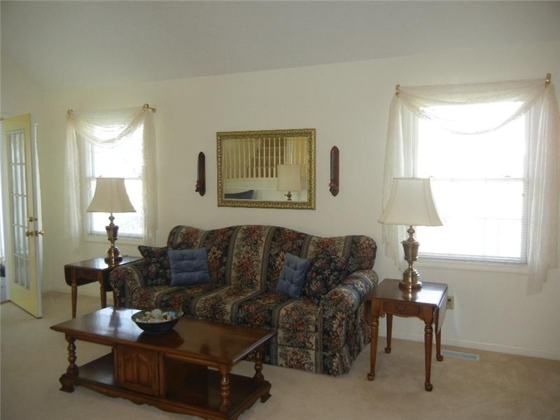 Vaulted great room with access to enclosed sun room!