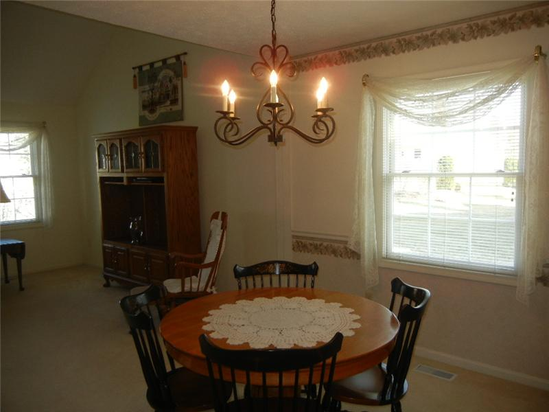 Pretty dining room is adjacent to the great room and both are decorated in soft neutral tones.