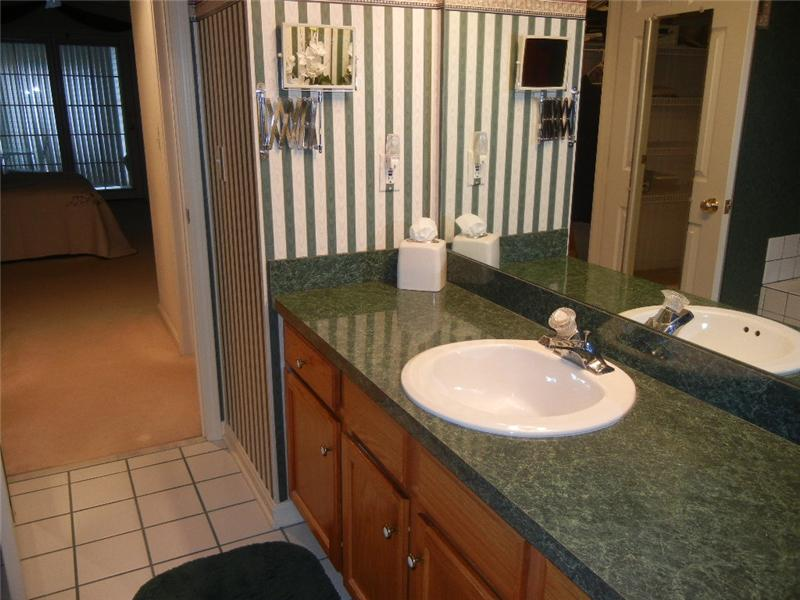 Large private master bath with soaking tub and ceramic tile flooring!