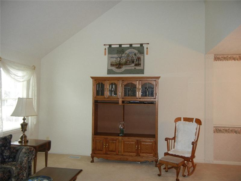 Vaulted great room makes it easy to set up an entertainment center or your favorite bookshelves!