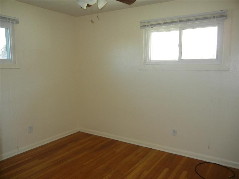 All three bedrooms have hardwood floors and ceiling fans