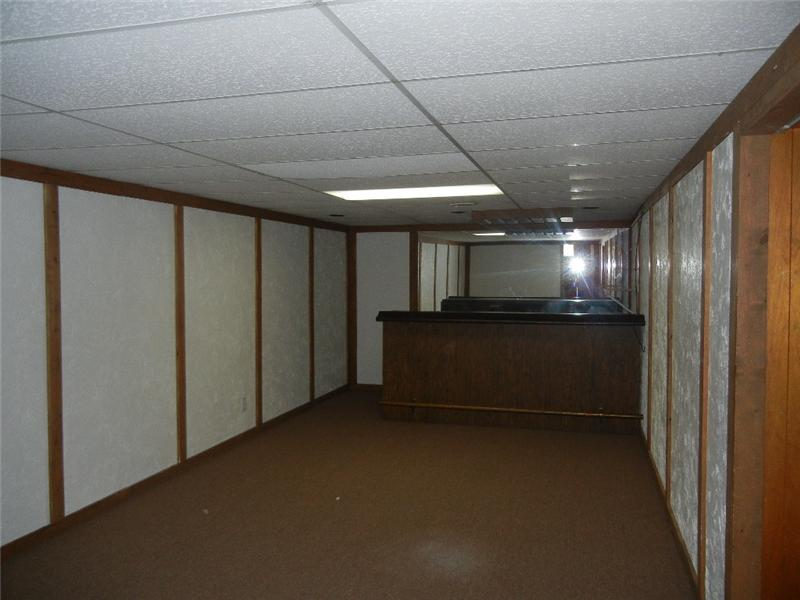 Finished side of basement with newer carpeting....