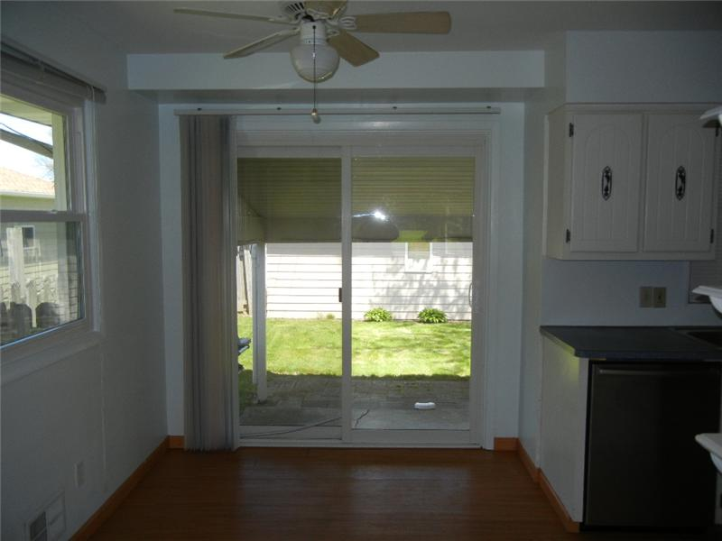 View from living room to kitchen with newer laminate flooring...