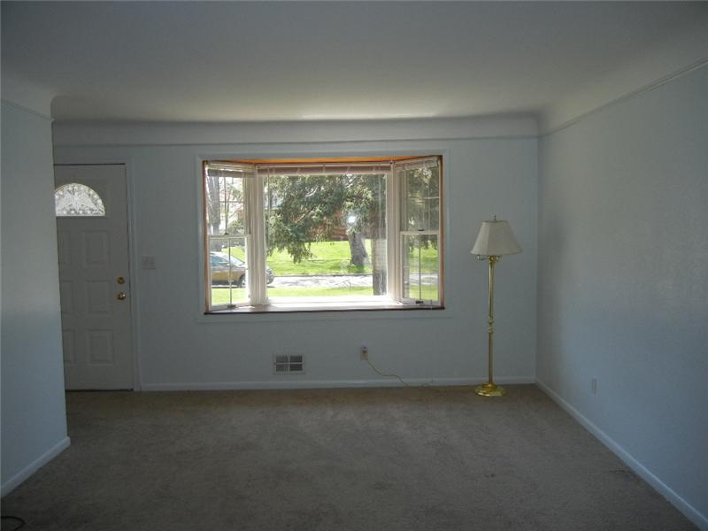 Pretty living room with newer neutral carpeting!