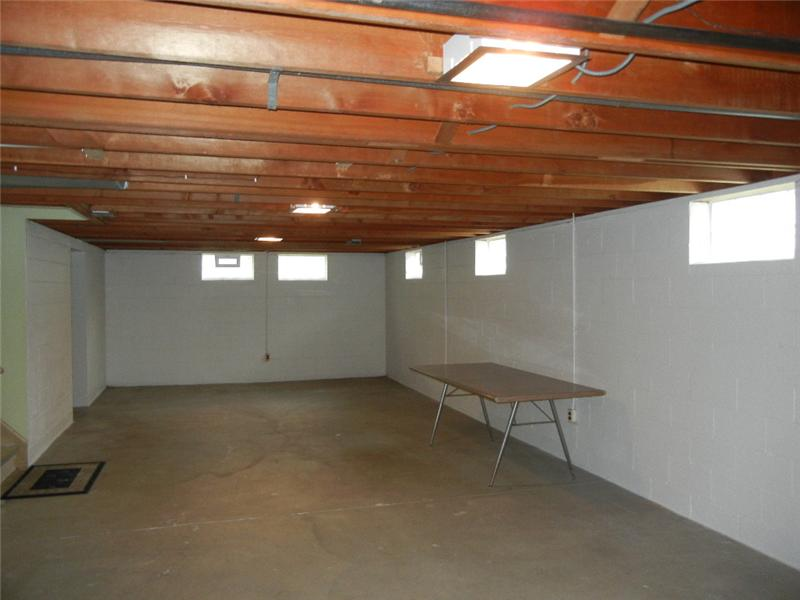 Full divided basement with glass block windows offers lots of possibilities for a recreation room and plenty of storage!