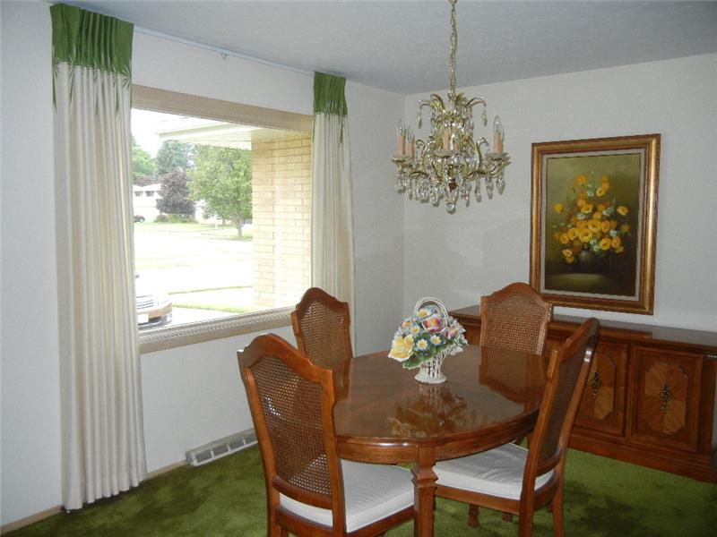 Pretty formal dining room, but the chandelier does not stay. Hardwood floors underneath the carpeting!