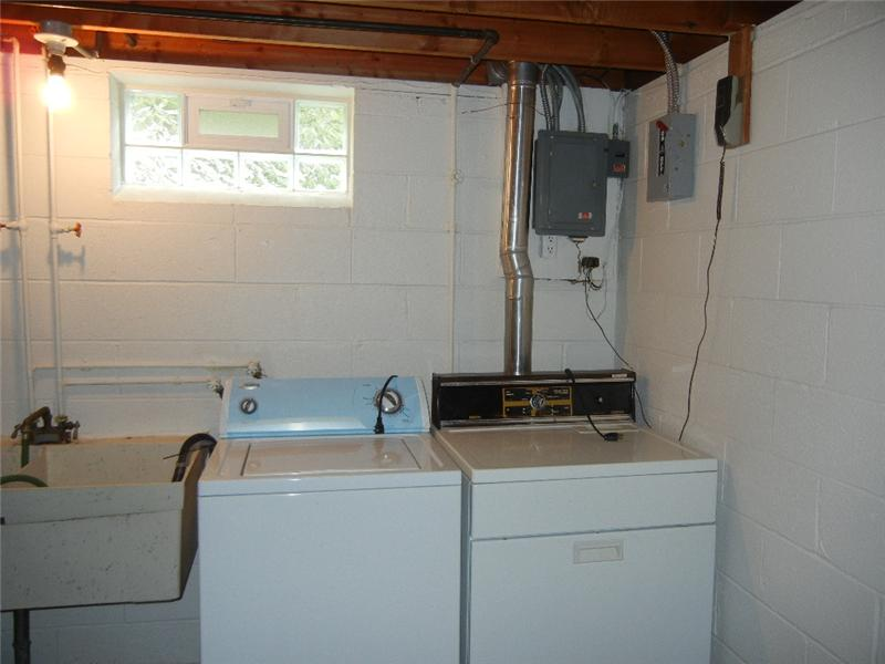 This laundry area includes the washer (newer and very gently used) and dryer.  Updated electric panel too!
