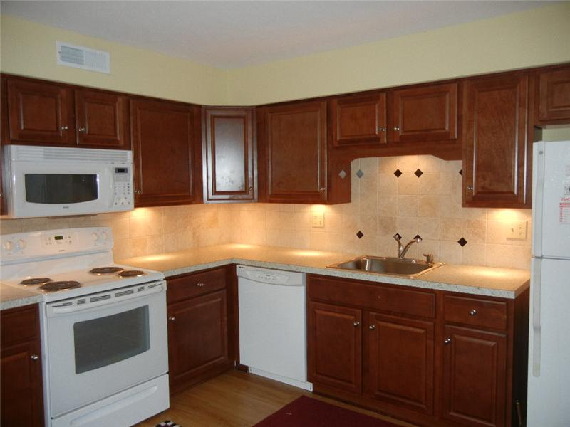 Beautiful kitchen with laminate flooring, ceramic tile back splash and all appliances included!