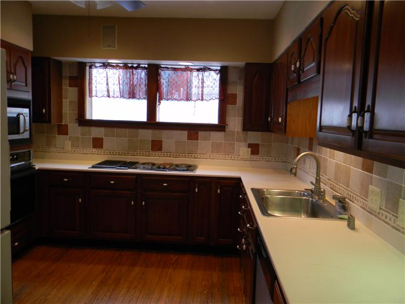 Corian countertops, recessed lighting