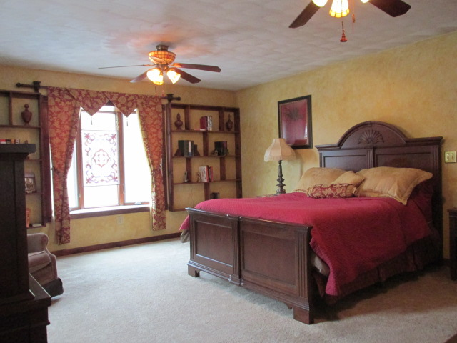 Master bedroom suite with ceiling fans