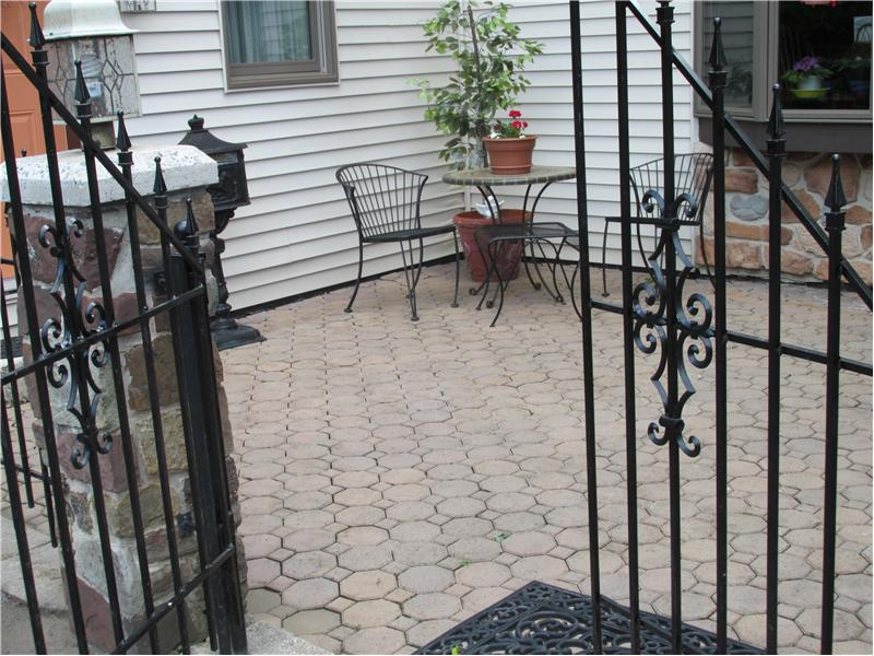 Paver patio leading into the house