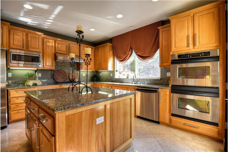 Beautifully appointed with granite counters, stone floors, maple cabinets, and stainless applicances.