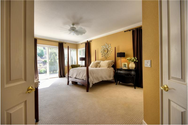 Large Master bedroom has 2 walk-in closets and outside access.