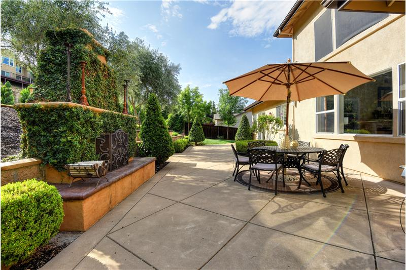 Fabulous back yard includes outdoor fireplace.